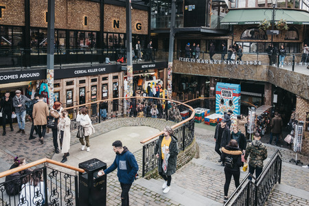 London, UK - March 23,2019: People walking inside Camden Stables Market, London. Started with 16 stalls in March 1974, Camden Market is one of the busiest retail destinations in London.
