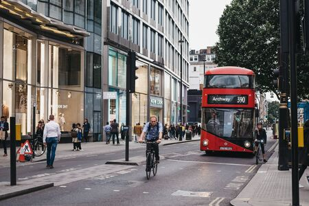London, UK - June 5, 2019: Cyclists and bus on Oxford Street, a major road in the City of Westminster in the West End of London, United Kingdom. Éditoriale