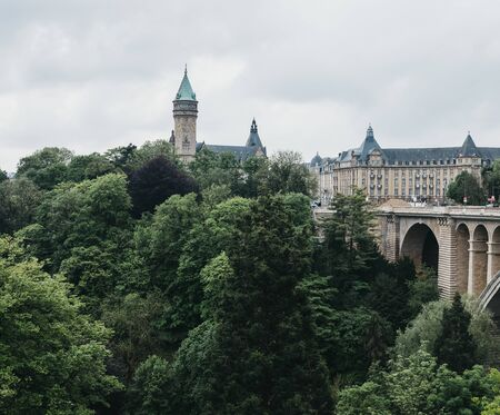 Luxembourg City, Luxembourg - May 19, 2019: Panoramic view of Adolphe Bridge over a park in Luxembourg City. One third of the surface of the city is shaped by beautifully landscaped green spaces.