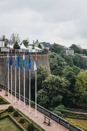 Luxembourg City, Luxembourg - May 19, 2019: View of Constitution Square in Luxembourg City over the greenery. One third of the surface of the city is shaped by beautifully landscaped green spaces.