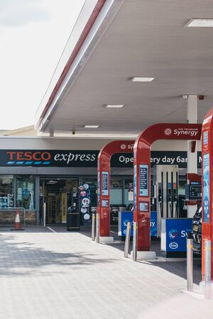 London, UK - July 16, 2019: View of Tesco Express shop at Esso petrol station in London, UK. Tesco is a British multinational groceries and general merchandise retailer.