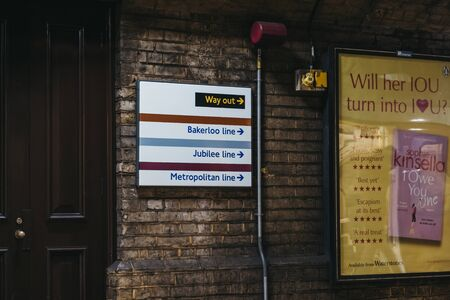 London, UK - July 29, 2019: Direction sign towards Bakerloo, Jubilee and Metropolitan lines in London Underground. London Underground is the oldest underground in the world