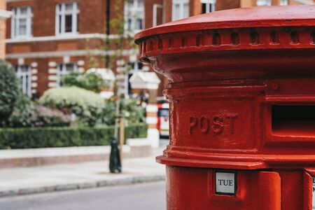 Close up of a red post box on a street in London, UK, shallow focus.