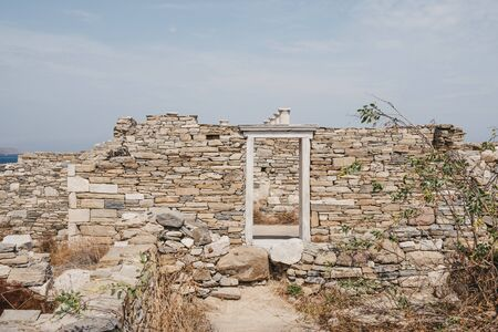 Ruins of ancient houses on the island of Delos, Greece, an archaeological site near Mykonos in the Aegean Sea Cyclades archipelago.