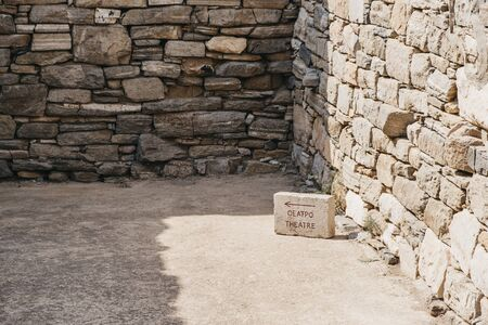Directional sign toward the theatre on the Greek island of Delos, archaeological site near Mykonos in the Aegean Sea. 写真素材