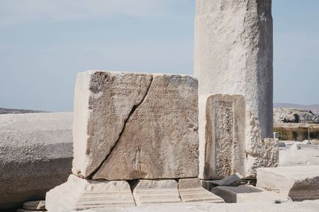 Text on the ruins on Sacred Way in island of Delos, an archaeological site in Greece near Mykonos in the Aegean Sea Cyclades archipelago.