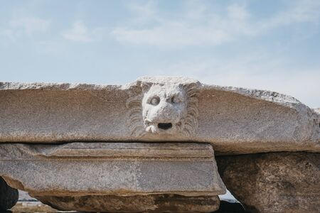 Architectural head details on the ruins on Sacred Way in island of Delos, an archaeological site in Greece near Mykonos in the Aegean Sea Cyclades archipelago.