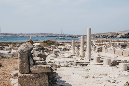 The remains of a building located to the northwest of the three Temples of Apollo on the island of Delos, Greece, an archaeological site near Mykonos in the Aegean Sea Cyclades archipelago.