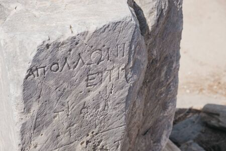 Writings on the ruins on Sacred Way in island of Delos, an archaeological site in Greece near Mykonos in the Aegean Sea Cyclades archipelago.
