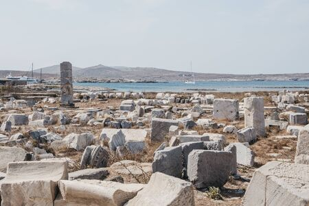 Ruins and columns on the island of Delos, Greece, an archaeological site near Mykonos in the Aegean Sea Cyclades archipelago.