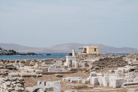 View of the ruins on the island of Delos, Greece, an archaeological site near Mykonos in the Aegean Sea Cyclades archipelago.
