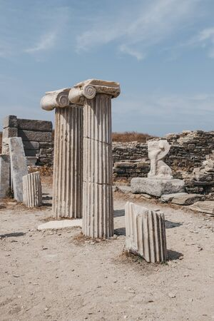 Columns and ruins on the Sacred Way on the island of Delos, Greece, an archaeological site near Mykonos in the Aegean Sea. Selective focus. 写真素材