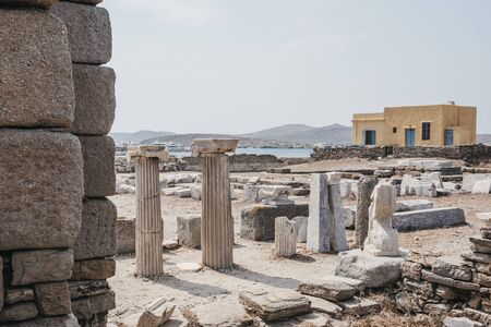 Columns and ruins on the Sacred Way on the island of Delos, Greece, an archaeological site near Mykonos in the Aegean Sea. Selective focus.