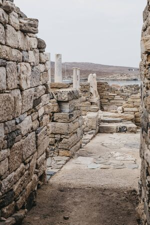 Statues and ruins on the Greek island of Delos, archaeological site near Mykonos in the Aegean Sea Cyclades archipelago.