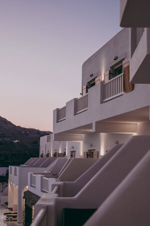 Exterior of a building in traditional Cycladic style in Mykonos, Greece, during blue hour.