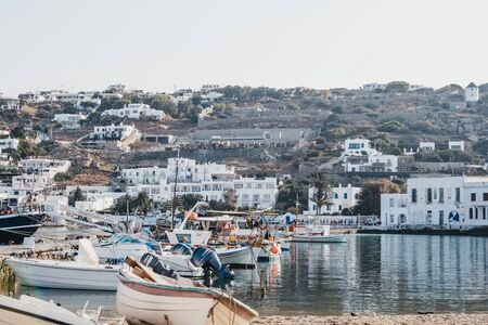 Mykonos Town, Greece - September 20, 2019: Boats moored by new port in Hora, also known as Mykonos Town, capital of the island and one of the best examples of Cycladic architecture.