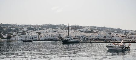 Mykonos Town, Greece - September 20, 2019: Panoramic view of boats in new port in Hora, also known as Mykonos Town, capital of the island and one of the best examples of Cycladic architecture. 新聞圖片