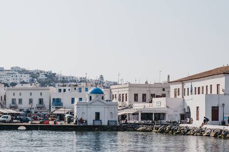 Mykonos Town, Greece - September 20, 2019: From the water view of new port in Hora, also known as Mykonos Town, capital of the island and one of the best examples of Cycladic architecture.