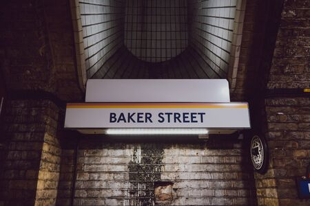 London, UK - November 26, 2019: Station name sign on the platform of Baker Street station, London. London Underground is the oldest underground railway in the world. 에디토리얼
