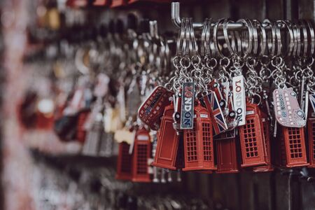 London, UK - November 26, 2019: London red post box key chains on sale at a street market in London, one of the most visited cities in the world.