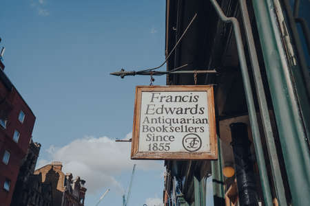London, UK - March 06, 2020: Sign outside Francis Edward, an antiquarian bookshop in Covent Garden, a famous tourist area in London with lots of shops and restaurants.