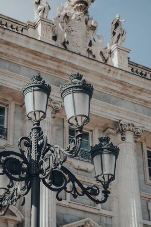 Street lamp against the exterior of Amudena Cathedral (Catedral de la Almudena), a Catholic church in Madrid, Spain.