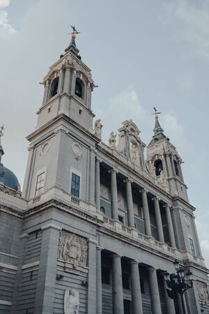 Low angle view against sky of Amudena Cathedral (Catedral de la Almudena), a Catholic church in Madrid, Spain. Фото со стока