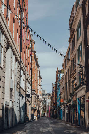 London, UK - June 13, 2020: Closed bars and restaurants in Kingly Street, famous street in Soho running from Liberty Mall and parallel and between Regent Street and Carnaby Street.