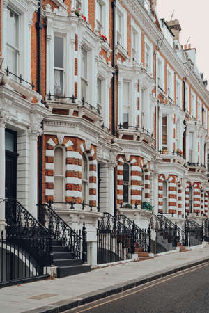 Row of traditional Victorian houses with stoops in Kensington and Chelsea, London, UK. Stock Photo