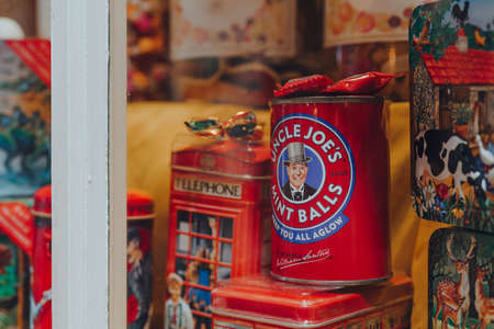 Broadway, UK - July 07, 2020: Retro jars with cookies and candy in a window of a shop in Broadway, a large historic village within the Cotswolds in the county of Worcestershire, England.