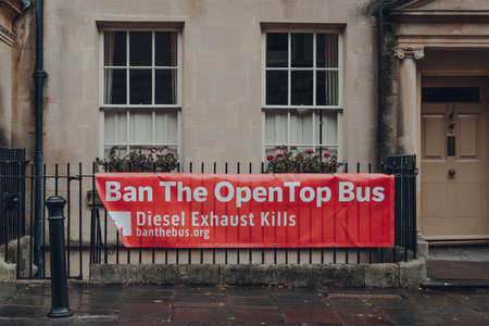 Bath, UK - October 04, 2020: Ban the OpenTop Bus sign by the campaign against air pollution in Bath, the largest city in the county of Somerset, England, selective focus.