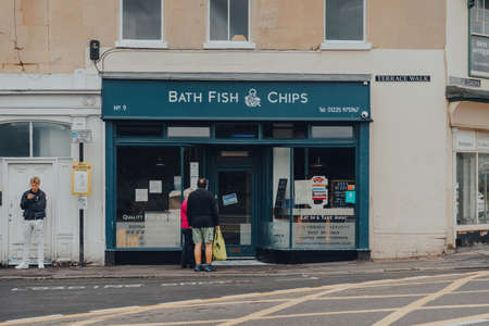 Bath, UK - October 04, 2020: People outside closed Fish and Chips shop in Bath, the largest city in the county of Somerset, England, known for and named after its Roman-built baths. Sajtókép