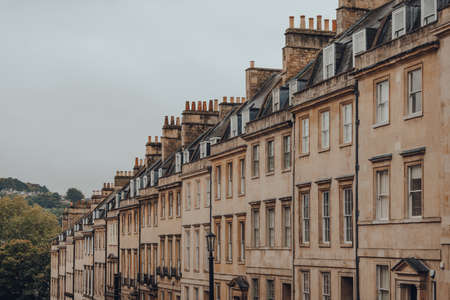 Row of old stone terraced houses on a street in Bath, Somerset, UK. Stock fotó