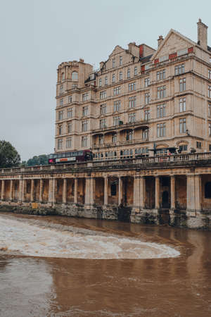 Bath, UK - October 04, 2020: View of buildings on Grand Parade by River Avon in Bath, the largest city in the county of Somerset, England, known for and named after its Roman-built baths. Sajtókép