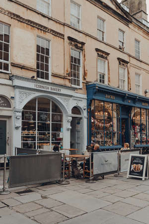 Bath, UK - October 04, 2020: The Cornish Bakery cafe in Bath, the largest city in the county of Somerset known for and named after its Roman-built baths, people sitting at the outdoor tables. Sajtókép