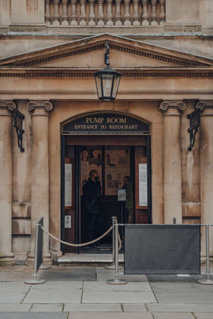 Bath, UK - October 04, 2020: Entrance to the Pump Room Restaurant, a well-preserved Roman site for public bathing, security guard in face mask seen inside. Sajtókép