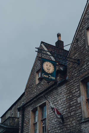 Frome, UK - October 04, 2020: Sign outside Sun Inn pub and accommodation in Frome, a market town in the county of Somerset, UK, famous for its market and independent shops.
