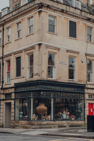 Bath, UK - October 04, 2020: Facade of closed Tully & George gift shop in Bath, the largest city in the county of Somerset, England, known for and named after its Roman-built baths. Sajtókép