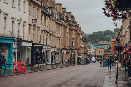 Bath, UK - October 04, 2020: View of a Milsom Street, a famous shopping street in Bath, the largest city in the county of Somerset, England, known for and named after its Roman-built baths.