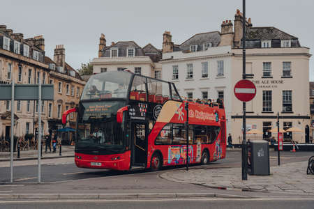 Bath, UK - October 04, 2020: Open Top  tour bus on a street in Bath, the largest city in the county of Somerset known for and named after its Roman-built baths.