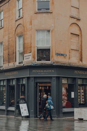 Bath, UK - October 04, 2020: Facade of Penhaligons shop in Bath, the largest city in the county of Somerset known for and named after its Roman-built baths, people walk past, motion blur. Sajtókép