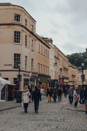 Bath, UK - October 04, 2020: People walking on Stall Street in Bath, the largest city in the county of Somerset known for and named after its Roman-built baths.