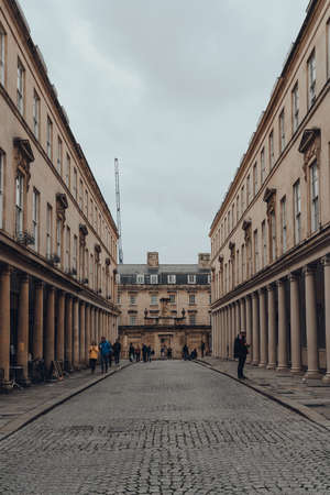 Bath, UK - October 04, 2020: View of Bath street in Bath, the largest city in the county of Somerset known for and named after its Roman-built baths.