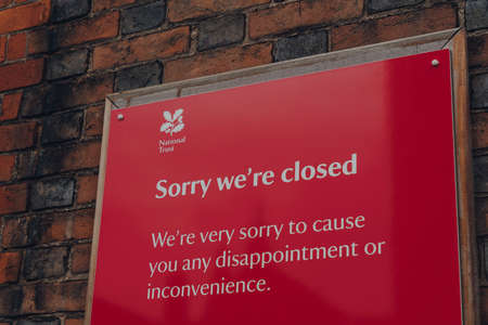 Rye, UK - October 10, 2020: Close up of Sorry We Are Closed sign outside National Trust Lamb House in Rye, one of the best-preserved medieval towns in East Sussex, England.