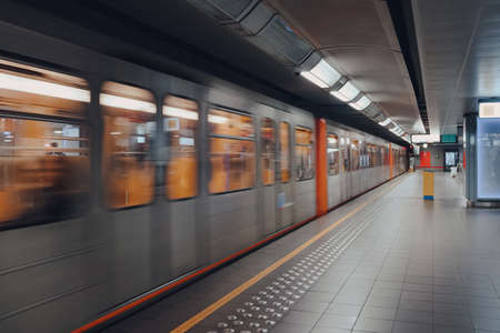 Brussels, Belgium - August 16, 2019: Train departing Brussels Metro station, speed motion blur. Consisting of four metro and three premetro lines it serves a large part of the Brussels-Capital Region