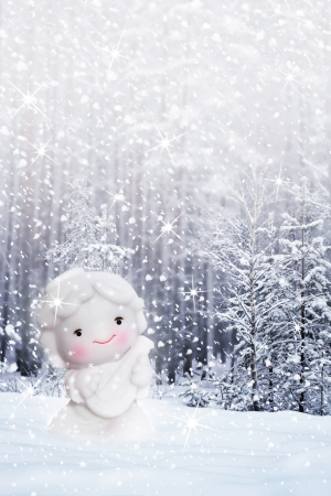 Angel on background of a winter landscape. Christmas. photo