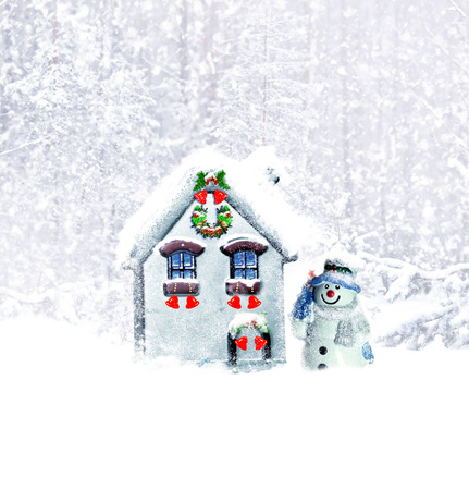 Cabin in the woods. Snowman in a winter forest.