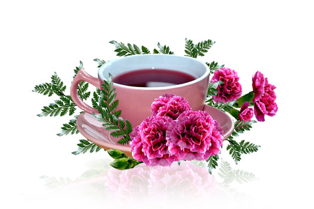 Cup of tea and flowers photo