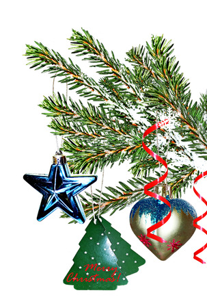 frippery: The branch of a Christmas tree decorated with toys and isolated on a white background