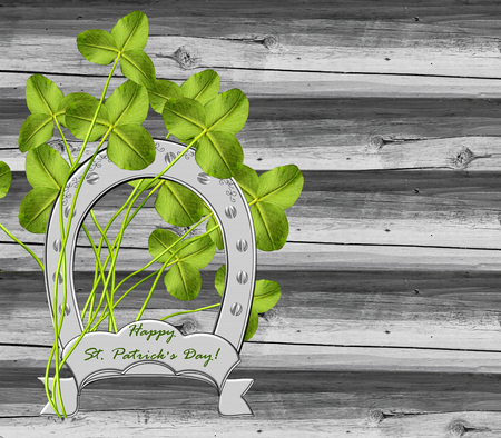 four leafed clover: clover and horseshoe Stock Photo